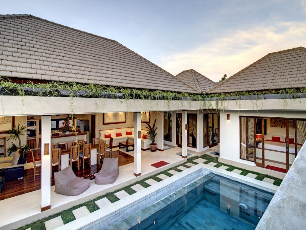 Bali family villas. relaxing pool side with a comfort bean bag